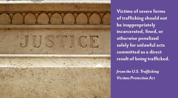 photograph of pillars of justice with statistic about human trafficking